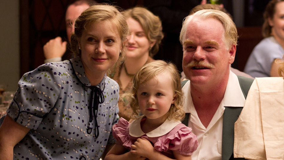 """In Paul Thomas Anderson's <em>The Master,</em> Amy Adams plays Peggy Dodd, the spouse of a charismatic spiritual leader, played by Philip Seymour Hoffman. Adams says her character is smart and educated but feels """"more powerful behind a man than in front of a man."""" (The Weinstein Co.)"""