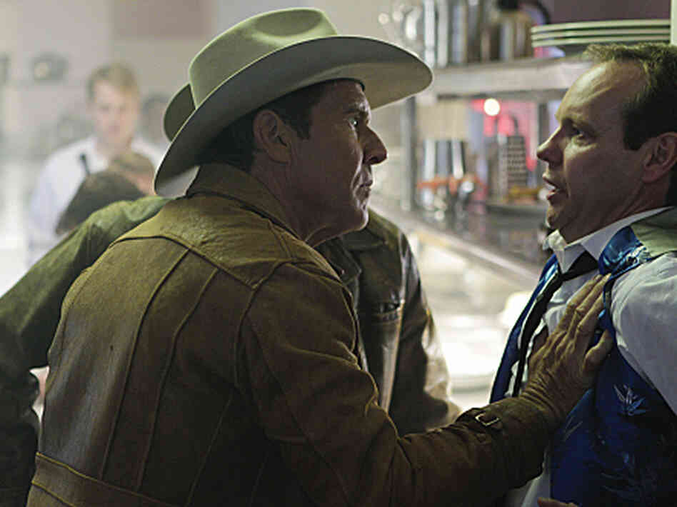 Sheriff Ralph Lamb (Dennis Quaid) questions a casino worker while investigating the murder of a craps dealer on the new CBS drama Vegas.