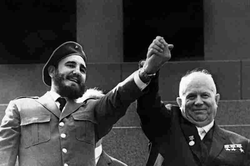 Castro holds the hand of Soviet leader Nikita Khrushchev during a four-week official visit to Moscow in May 1963.