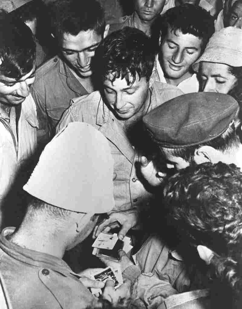 Sharon (center), as a young officer, is surrounded by comrades in Israel on Dec. 1, 1956. Sharon was an important figure in forming Unit 101, an elite commando force known for its counterterrorist operations against Palestinians in the 1950s.
