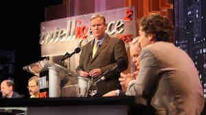 John Donvan of ABC News moderates an Intelligence Squared debate on the regulation of money in politics.