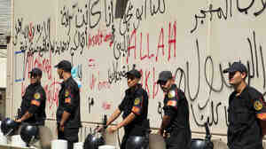 Security guards were deployed outside the graffiti-covered walls of the U.S. Embassy in Cairo, Egypt, which came under attack Tuesday.