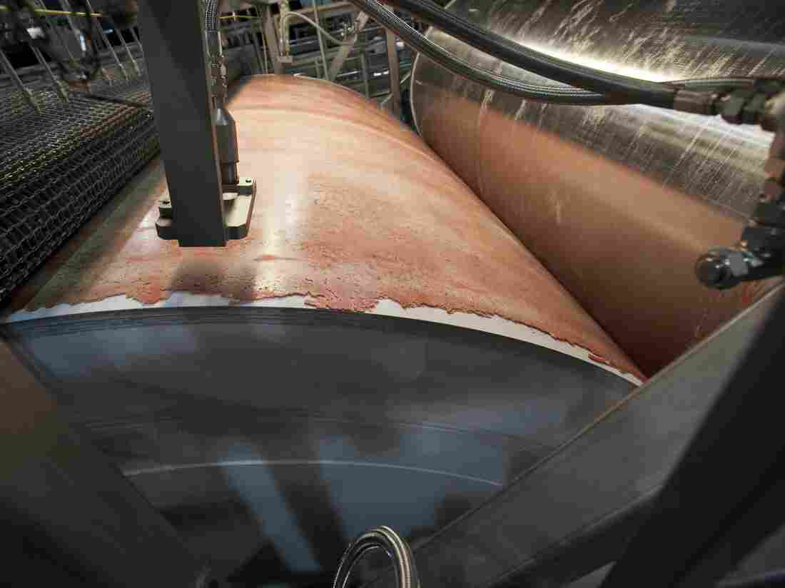 "Lean, finely textured beef, dubbed ""pink slime"" by critics, is frozen on a large drum as part of its manufacturing process at the Beef Products Inc.'s plant in S. Sioux City, Neb. in March."