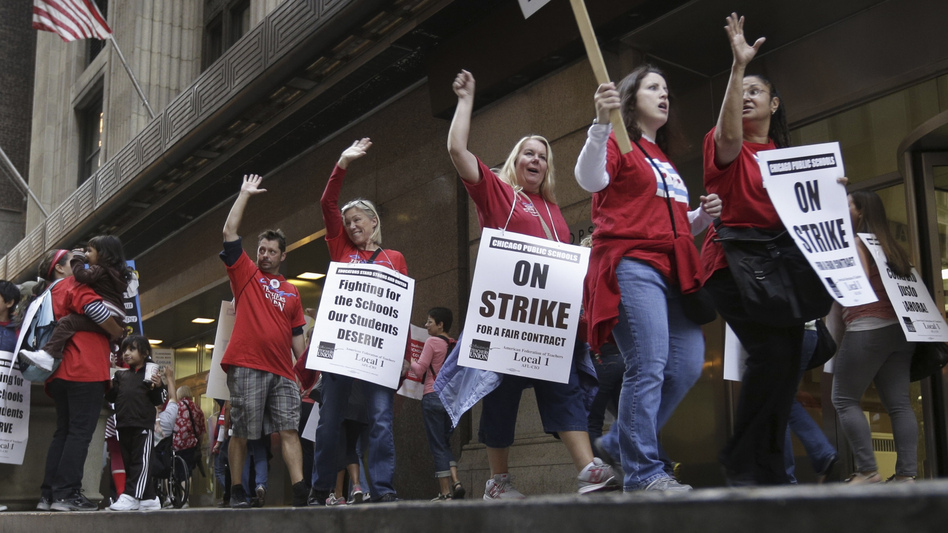 Chicago Teachers Union members picket the CPS headquarters in Chicago on Thursday, the fourth day of their strike.