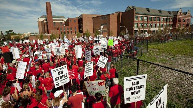 A crowd of Chicago public school teachers marches past J