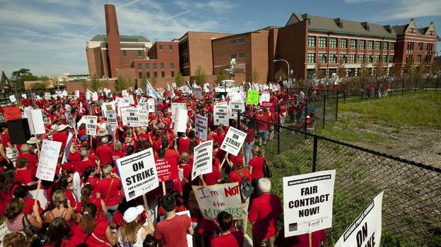 A crowd of Chicago public school teachers marches past John Marshall Metropolitan High School on Wednesday, Sept. 12. (AP)