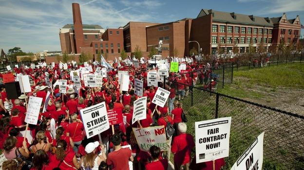 A crowd of Chicago public school teachers marches past John Marshall Metropolitan High School on Wednesday, Sept. 12. (AP)