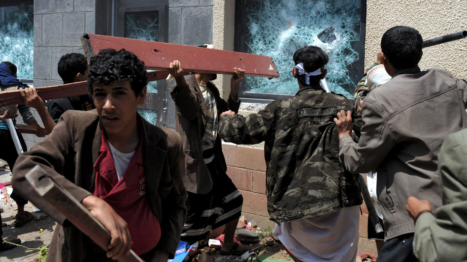 A mob in Yemen attacks the U.S. Embassy during a protest against a film they say insults the Prophet Muhammad, in the capital, Sanaa, on Thursday. (EPA/Landov)