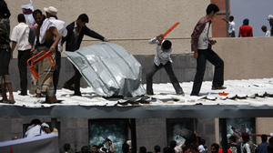 Yemeni protesters try to break through the U.S. Embassy in Sana'a during a protest over a film mocking Islam on Thursday. Yemeni forces managed to drive out angry protesters who stormed the embassy in the Yemeni capital with police firing warning shots to disperse thousands of people as they approached the main gate of the mission.