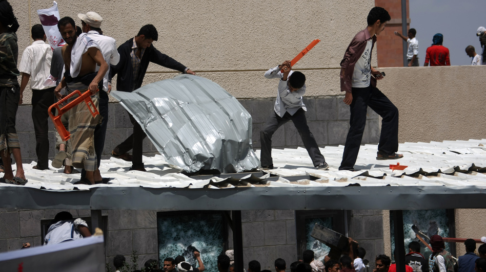 Yemeni protesters try to break through the U.S. Embassy in Sana'a during a protest over a film mocking Islam on Thursday. Yemeni forces managed to drive out angry protesters who stormed the embassy in the Yemeni capital with police firing warning shots to disperse thousands of people as they approached the main gate of the mission. (AFP/Getty Images)