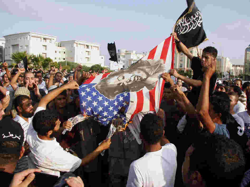 Protesters outside the U.S. embassy in Tunis burn an American flag bearing a portrait of Marilyn Monroe during a demonstration Wednesday against a film deemed offensive to Islam.