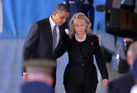 President Barack Obama and  Secretary of State Hillary Clinton return to their seats after speaking during the transfer of remains of the four Americans killed in an attack this week in Benghazi, Libya.