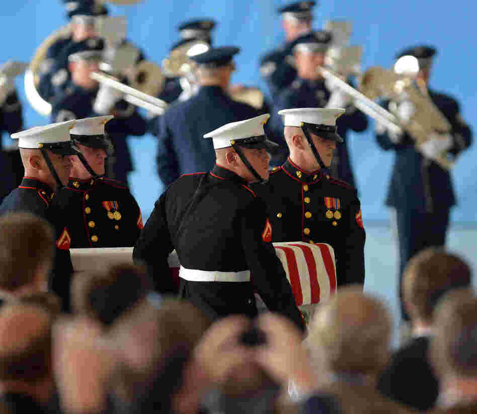 U.S. Marines carry a casket during the transfer of remains ceremony, marking the return of the remains of the four Americans killed in an attack this week in Benghazi, Libya.