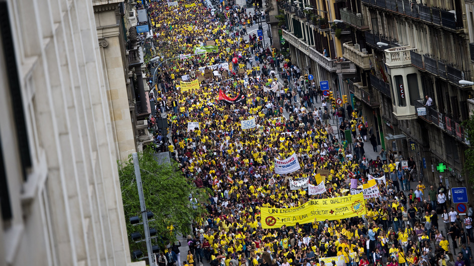 Thousands of teachers and students demonstrate during a protest against education cuts on May 22 in Barcelona, Spain. Teachers are planning another strike for later in September. (Getty Images)