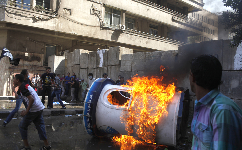 Protesters set a bank security booth on fire during a demonstration near the U.S. embassy in Cairo, Friday. (Reuters/Landov)