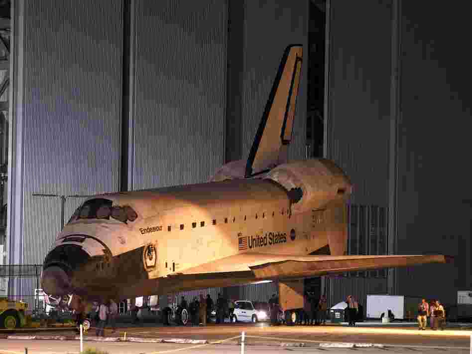 Space shuttle Endeavour is towed to the Kennedy Space Center landing facility in Cape Canaveral, Fla., on Friday.