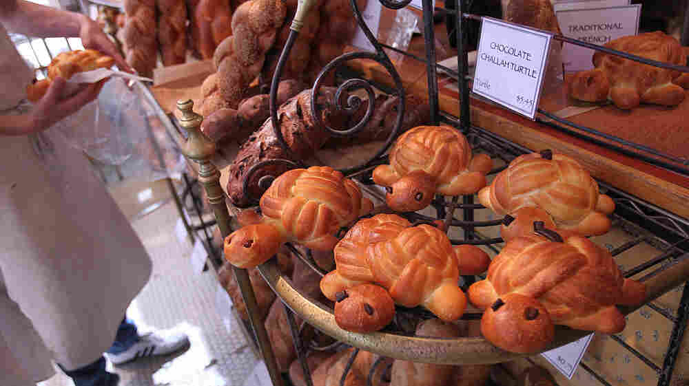 The traditional challah for the upcoming Jewish holiday, Rosh Hashana, is round. But as this bakery demonstrates, other shapes offer symbolic meanings.
