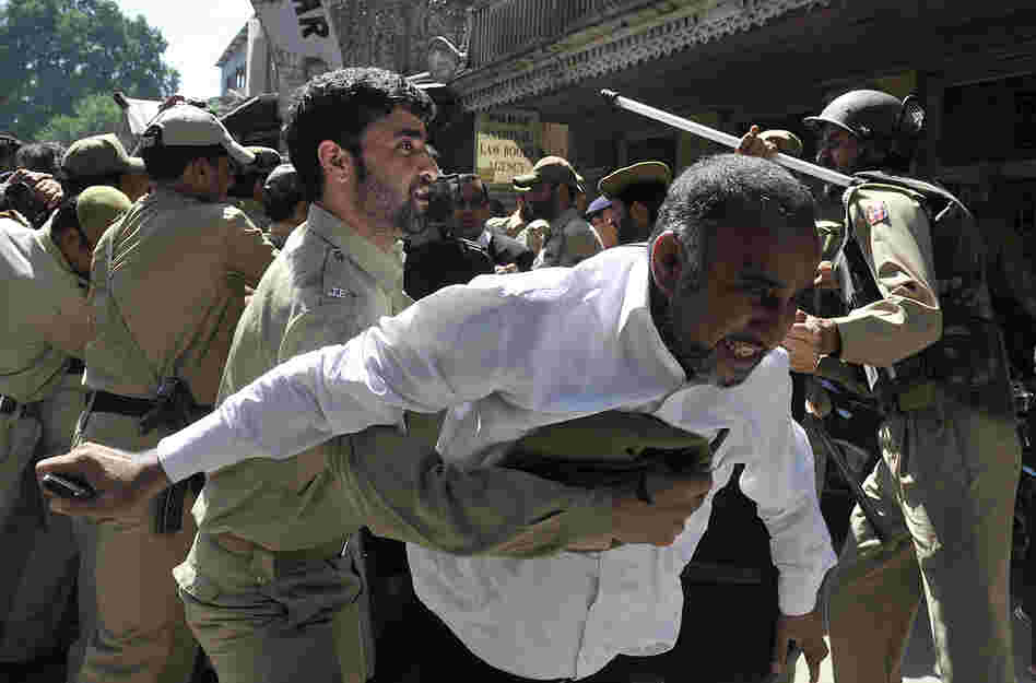 Police try to stop Kashmiri lawyers during a demonstration in Srinagar, India. The controversial low budget film portrays Muslims as immoral and gratuitous sparked fury in Libya, where four Americans including the ambassador were killed on Tuesday when a mob attacked the U.S. consulate in Benghazi.