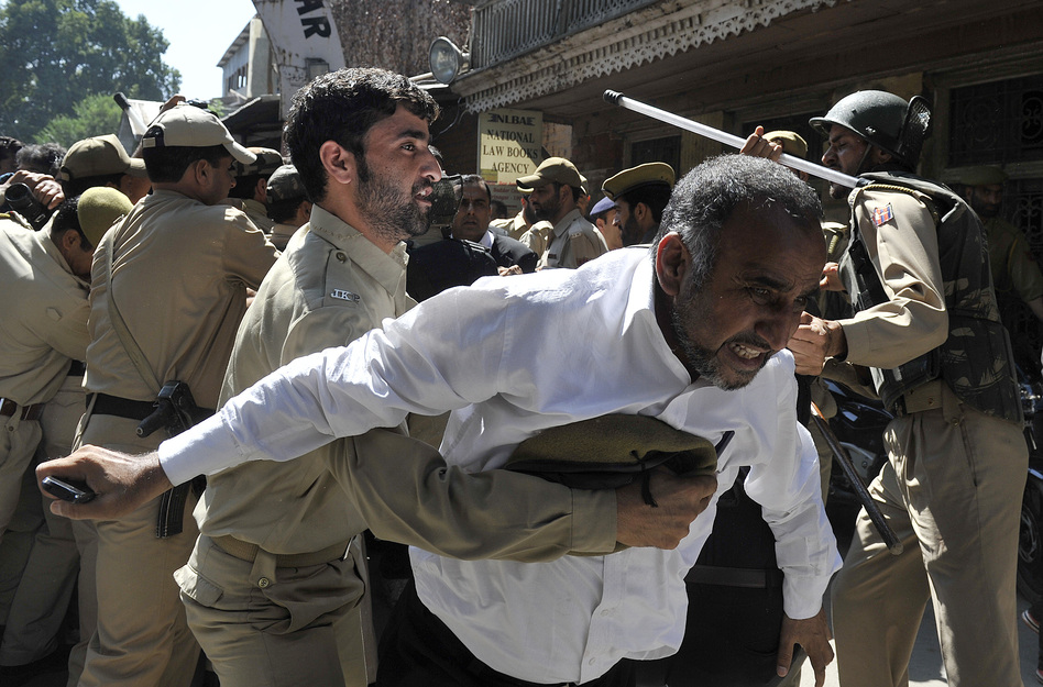 Police try to stop Kashmiri lawyers during a demonstration in Srinagar, India. The controversial low budget film portrays Muslims as immoral and gratuitous sparked fury in Libya, where four Americans including the ambassador were killed on Tuesday when a mob attacked the U.S. consulate in Benghazi. (AFP/Getty Images)
