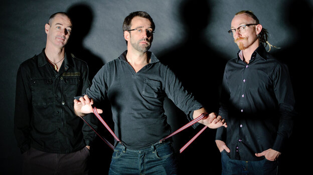 The Neil Cowley Trio is: (L-R) Evan Jenkins, Cowley, Rex Horan.