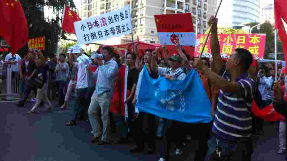 Protesters march outside the Japanese Embassy in Beijing on Saturday. Tension escalated, sometimes to violence, in cities across China after Japan bought the disputed islands from a private Japanese owner.