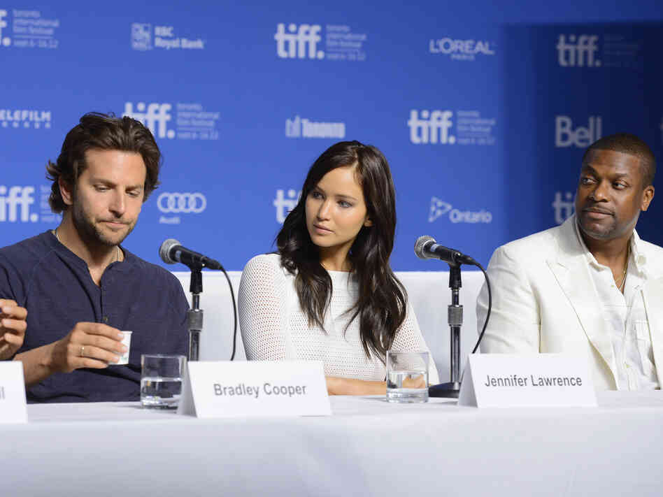 Actors Bradley Cooper (left), Jennifer Lawrence and Chris Tucker speak onstage at Silver Linings Playbook press conference Sept. 9 during the 2012 Toronto International Film Festival.