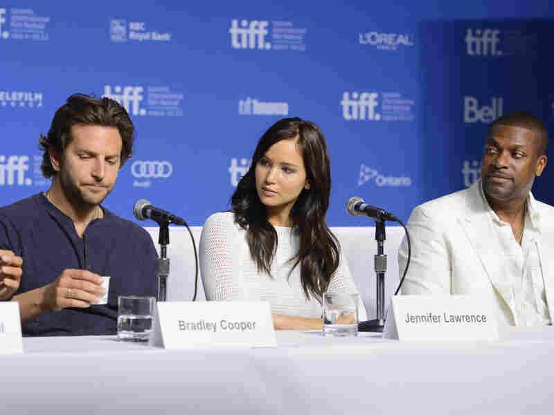 Actors Bradley Cooper (left), Jennifer Lawrence and Chris Tucker speak onstage at Silver Linings Playbook press conference Sept. 9 during the 2012 Toronto International Film Festival.