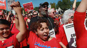 Striking Chicago teachers and their supporters attend a rally at Union Park Saturday in Chicago.