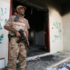 A Libyan military guard stands in front of one of the U.S. Consulate's burnt-out buildings in Benghazi Sept. 14 during the visit of President Mohammed el-Megarif.