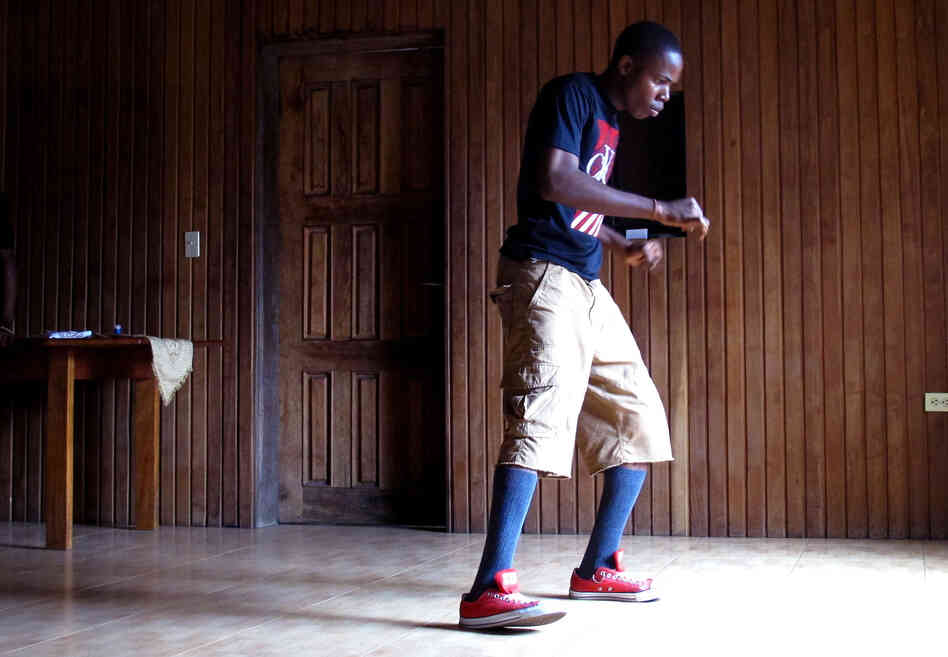 Franklyn Dunbar, 17, practices krumping with his crew at his mother's house in Paynesville, a suburb of Monrovia, Liberia. Dunbar was born in New York, but moved to his home country of Liberia seven years ago.