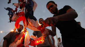 Libyan followers of the Ansar al-Sharia militant group burn the U.S. flag during a protest in  Benghazi, Libya, on Sept. 14.