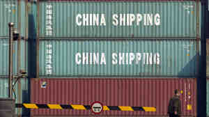 Shipping containers sit at a port in Tianjin, China, on Feb. 28.