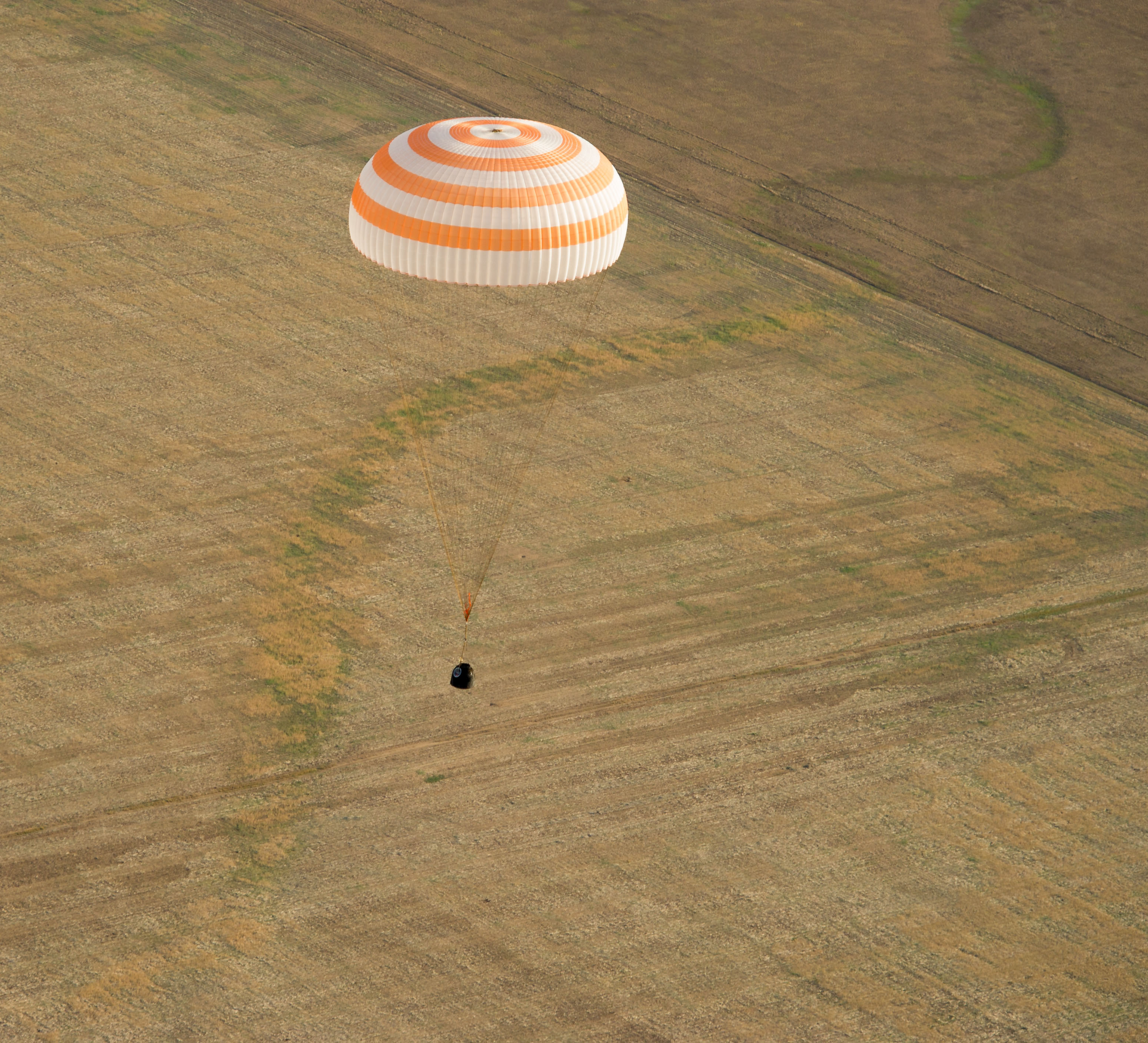 The Soyuz capsule floats as it brings Commander Gennady Padalka of Russia, NASA Flight Engineer Joe Acaba and Russian Flight Engineer Sergei Revin to a landing area near the town of Arkalyk, Kazakhstan. When it detached from the space station, the capsule was over Kenya.