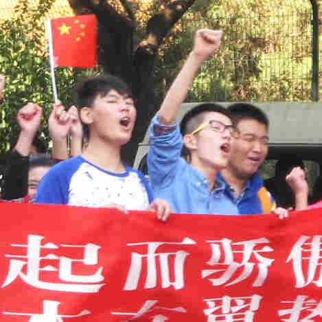"Protesters marched in front of the Japanese Embassy in Beijing today. They carried a banner declaring: ""We are proud of China's rise. We resolutely oppose Japan's rightist forces."""