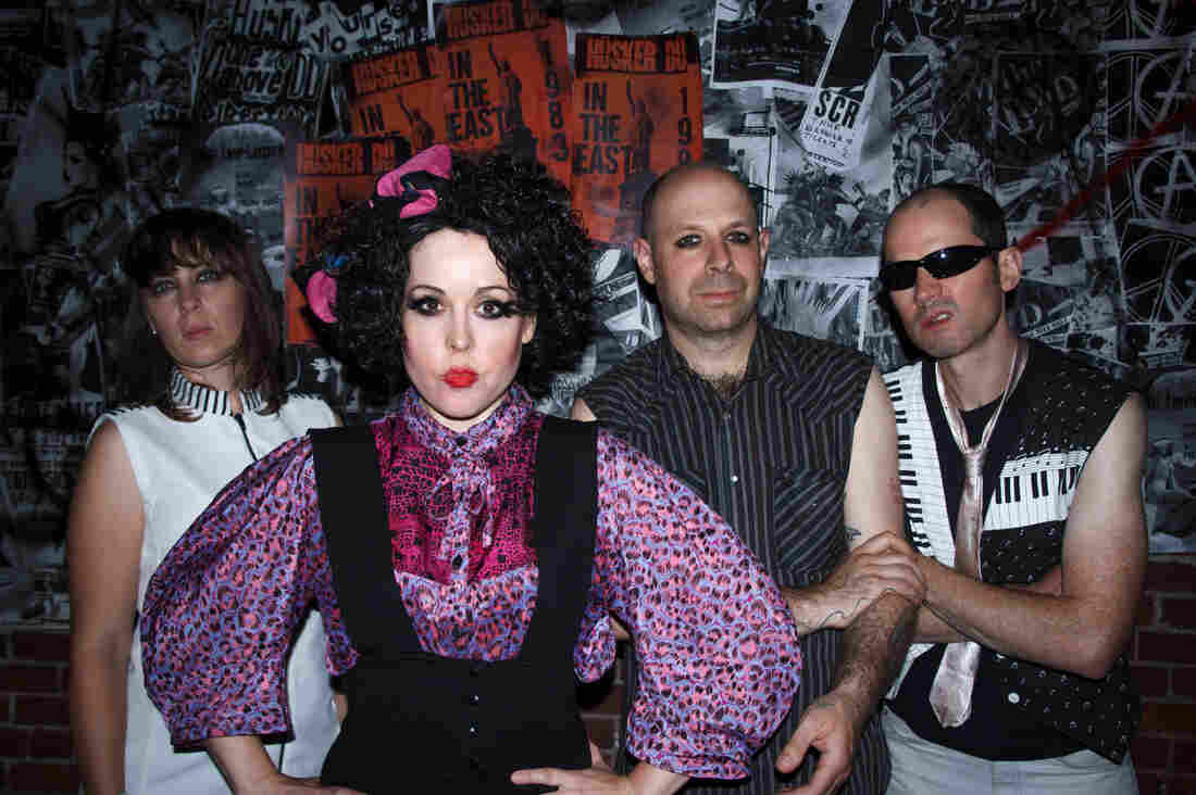 """The Corin Tucker Band, from left: Sarah Lund, Corin Tucker, Seth Lorinczi and Mike Clark — dressed up as X-Ray Spex in the video for """"Neskowin."""""""