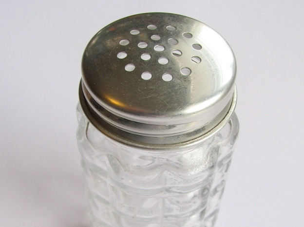 It's going to take a lot more than emptying the salt shaker to cut back on the sodium U.S. kids are getting. (Flickr.com)