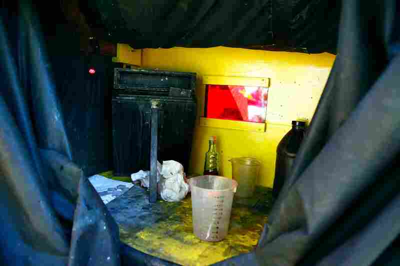 To work like Gardner did in the field, the photographer needs a portable darkroom. The interior of Todd Harrington's is like an alchemist's laboratory.