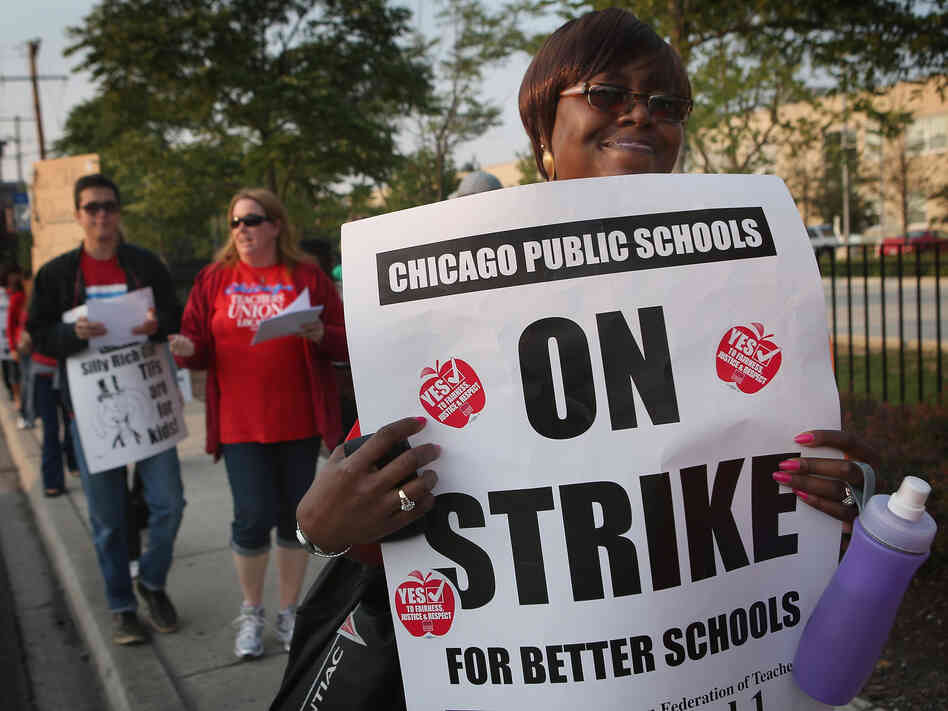 Striking Chicago public school teachers outside of George Westinghouse College Prep high school earlier today