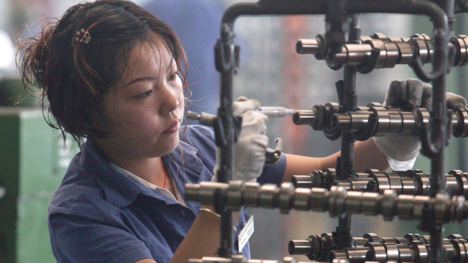 A worker inspects auto parts at a factory in Chengdu, China. (2005 file photo.) (Getty Images)