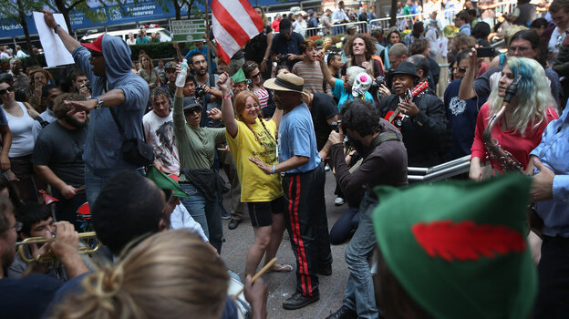 Protesters dance in Zuccotti Park on the one-year anniversary of the Occupy Wall Street movement.