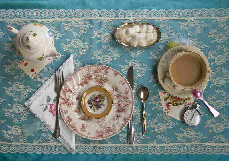 """""""There was a table set out under a tree in front of the house, and the March Hare and the Hatter were having tea at it ..."""" (Alice in Wonderland)"""