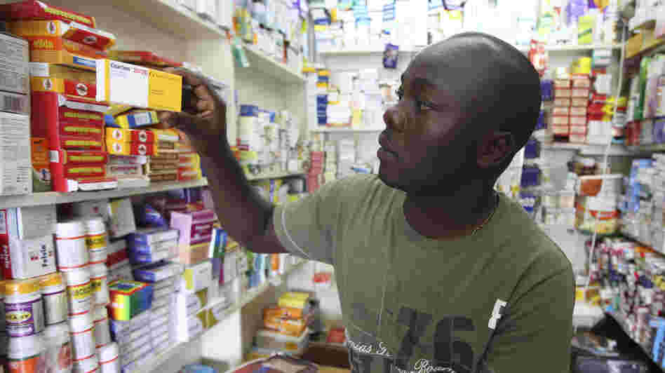 Ayo Bello grabs a box of malaria medication at a pharmacy in Lagos, Nigeria. A pilot project by the Global Fund has helped private pharmacies and clinics sell top quality malaria drugs at wholesale prices in Nigeria and seven other African countries.