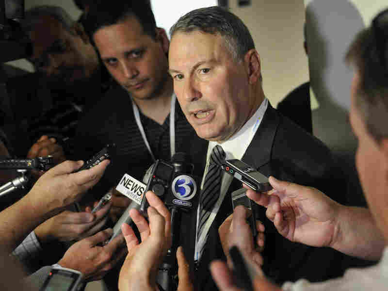 Big East commissioner Mike Aresco answers questions from the media before an NCAA college football game. Aresco says there are no plans for the conference to change its name.