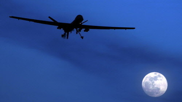 A U.S. Predator drone flies through the night sky over Kandahar Air Field in Afghanistan. Drone strikes ordered by the Obama administration have killed more than a dozen al-Qaida leaders around the world. (AP)