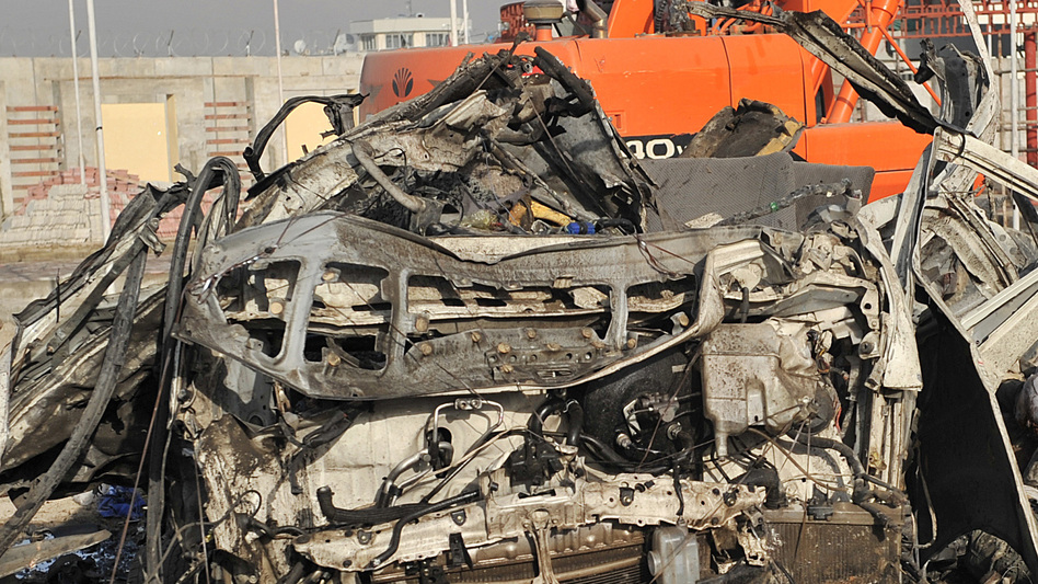 A suicide bomber struck a convoy of buses today in Kabul, killing at least 12 people — mostly foreigners. (AFP/Getty Images)