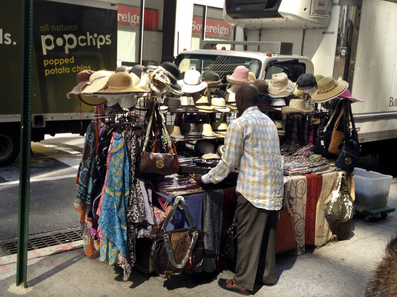 With Hats And Umbrellas, Senegalese Fill A City Niche : NPR