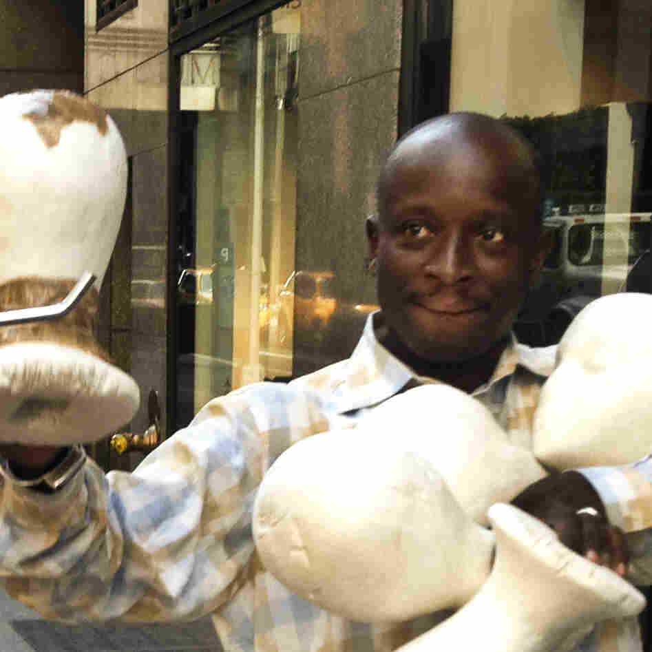 Senegalese vendor Cheikh Fall prepares his stall in front of Brooks Brothers on 51st Street, just off the Avenue of the Americas in New York City. Fall runs an association of Senegalese vendors that deals with the city over licensing and regulations.