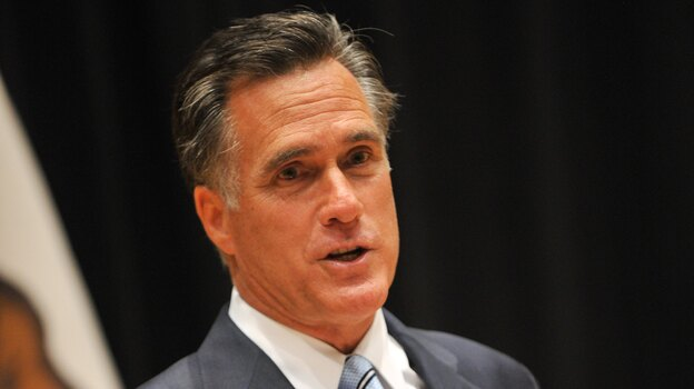 Republican presidential candidate Mitt Romney talking to reporters Monday in Costa Mesa, Calif. (AFP/Getty Images)