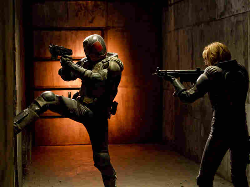 Judge Dredd and his protege, Anderson (Olivia Thirlby), fight a drug lord in a post-apocalyptic slum.