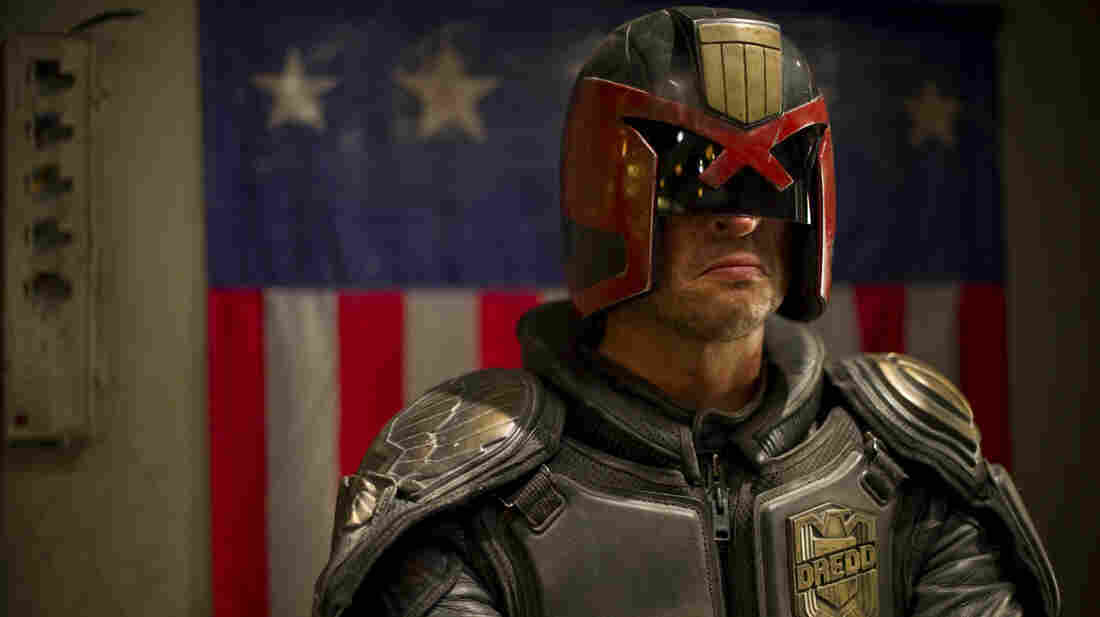 Judge Dredd (Karl Urban) is responsible for both convicting and punishing the criminals of Mega-City One.